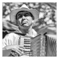 accordion-player-thoughtfully_13163610685_o-1-Custom